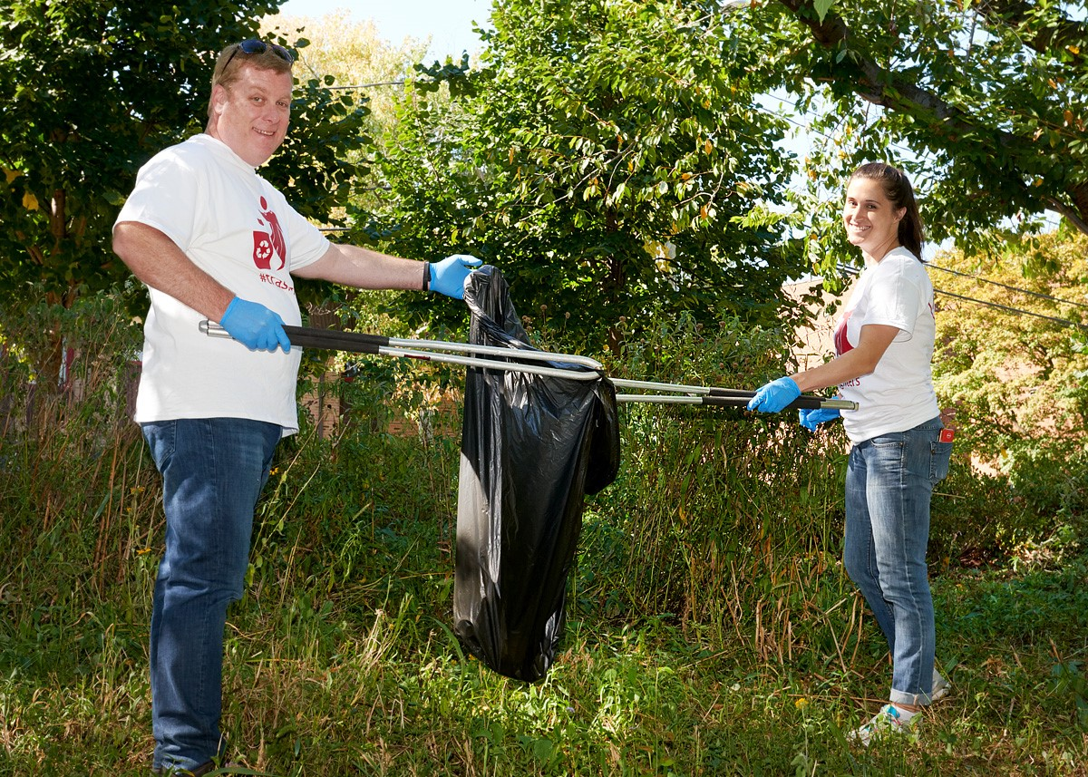 Henkel North America employees participate in #trashfighters initiative in Stamford's Mill River Park to clean up trash and raise awareness against plastic waste.
