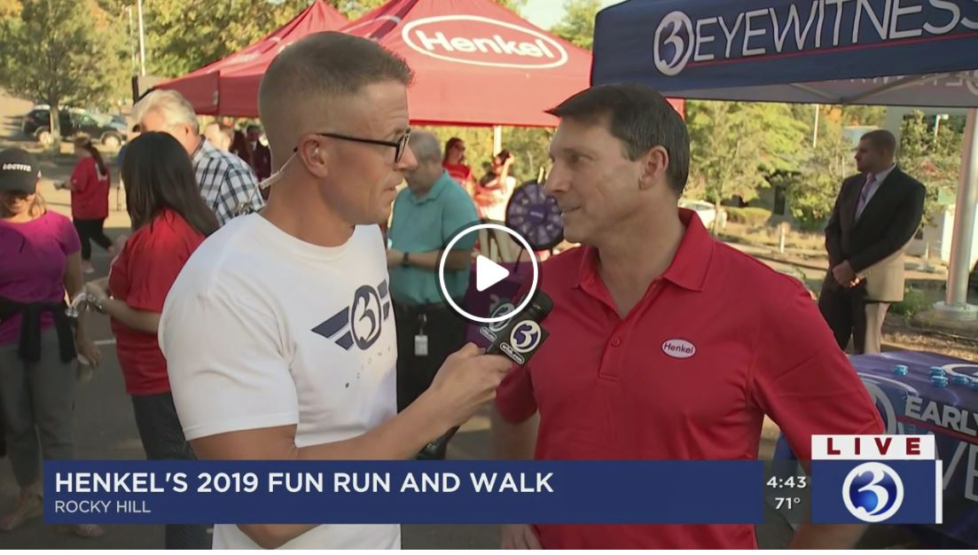 A screen capture of two men, interviewer and interviewee, at Henkel's 2019 Fun Run and Walk