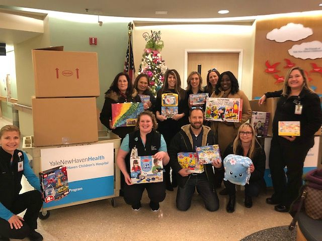 Members of the North America Legal Team collaborated to donate three boxes of toys and lift the spirits of kids at the Yale New Haven Children's Hospital.