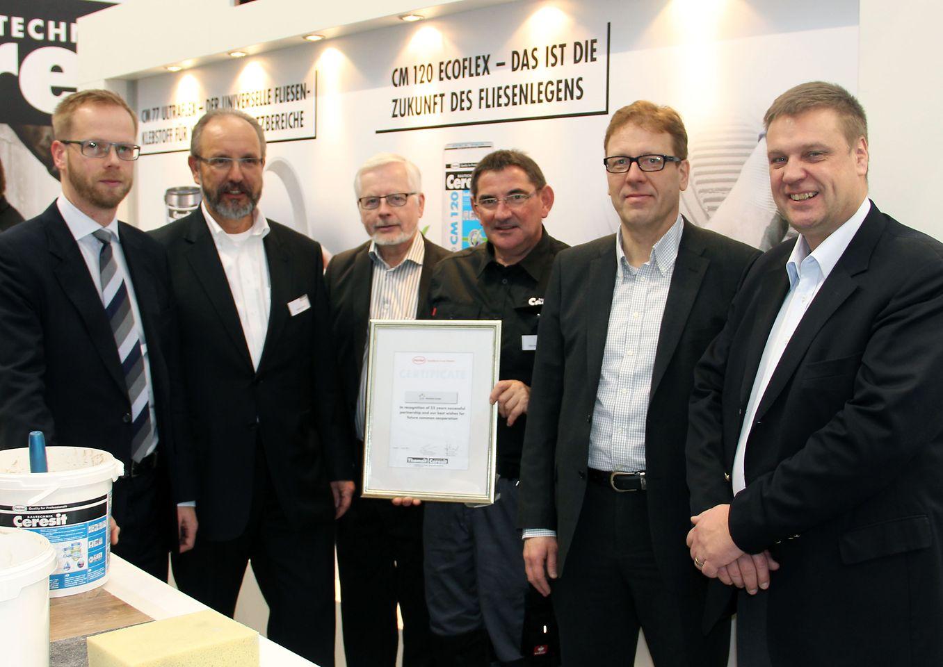 Vertreter der Ceresit Bautechnik und des finnischen Handelspartners Väritukku