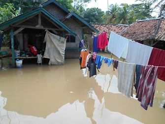 Houses in the isolated village, partially submerged by the flood