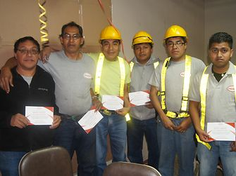 The employees received a diploma to commemorate the achievement.