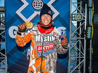 Levi LaVallee poses with his gold medal for the Long Jump in Aspen, USA