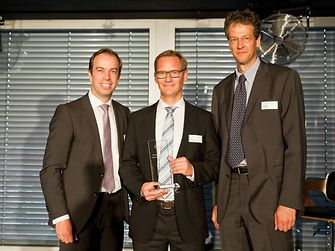 """Christian Kirsten, Corporate Senior Vice President Transport & Metal, Henkel Adhesive Technologies, presented the award for the best """"Suply Performance"""" to Udo Hünger, Global Key Account Manager, and Christoph Hansen, Group Vice President, BASF (from left to right)."""