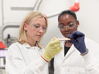 Two women in laboratory.