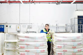Employee in Duesseldorf in a detergent packaging warehouse.