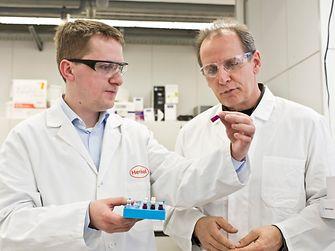 Laboratory Manager, Matthias Frischmann, and Rolf Herrmann investigate specimens in a Henkel Central Analytics lab