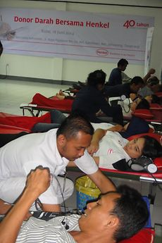 Indonesian employees line up to donate their blood