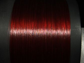 Measurement of gloss with colored hair strands