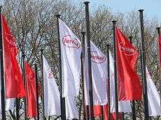 Henk logo on red and white flags