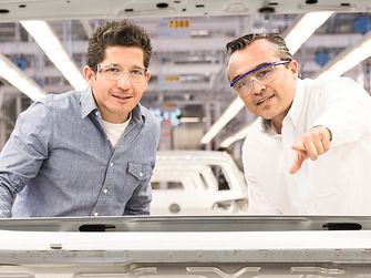 two-male-employees-in-automotive-production