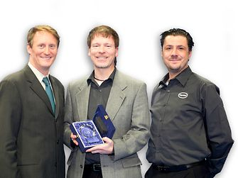 Henkel's Dr. Mark Currie (center) and Ian Wilding (right) accept Loctite GC 10's NPI Award