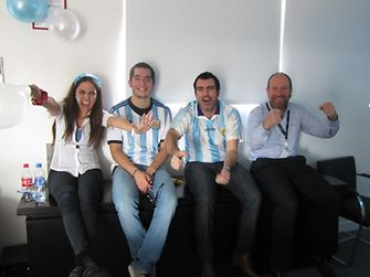 Employees of Henkel Argentina cheering for their favourite team