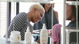 Lindiwe Radebe, from Schwarzkopf South Africa, is doing a model's make-up