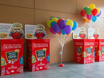 The bright red donation boxes at Henkel's offices in Milan