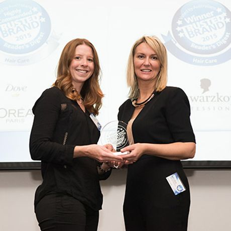 Jodie Lynch (left) receiving the Most Trusted Brand Award from Sheron White