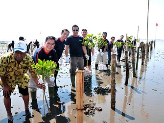 President of Henkel Indonesia, Allan Yong, with Kalpataru Winner, Bapak Mukarim and Henkel Employees Planting Mangrove in Mangrove Pasuruan Conservation Center