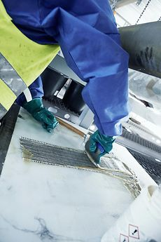 Applying Loctite PC 7210 to the glass-carbon fiber tape