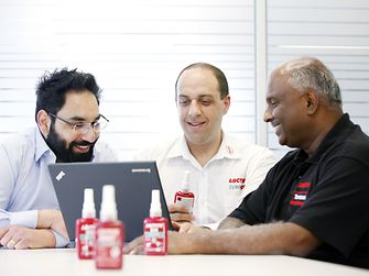 three-male-employees-with-loctite-products.jpg