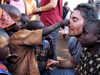 Uganda: Playing with children.