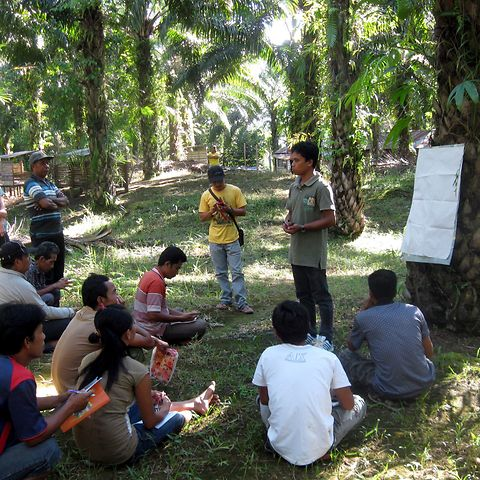 A trainer with his group in West Kalimantan