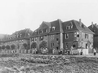 1911: The first company-owned apartments were built