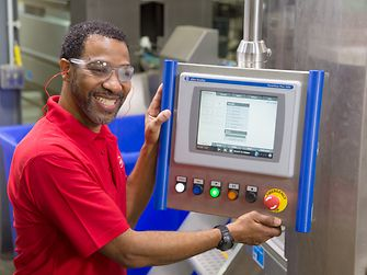 Mitchell McClerking from the St. Louis facility, works on the Renuzit® brand.