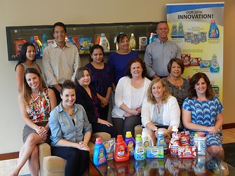 Employees beam with pride as they showcase some of the company's products