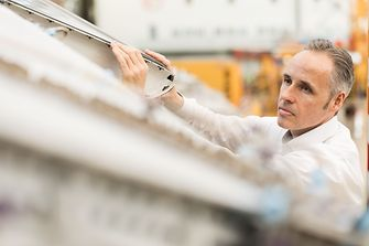 Henkel employee checks the optimal application of the Henkel products on the aircraft.