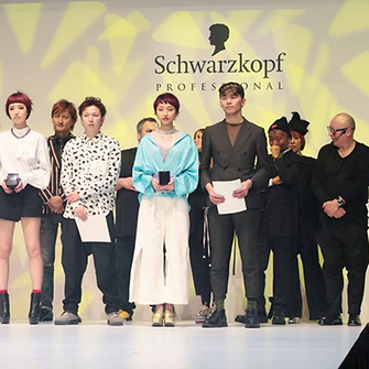 The winners and their hair models on stage