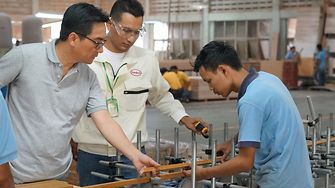 Mr. Ch'ng (left) with Henkel's expert (middle), doing quality inspection in YBWWI's plant.