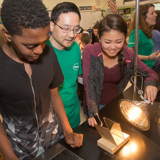 Henkel's Senior Research Scientist Stanley Kong teaches students about the thermal properties of solar film.
