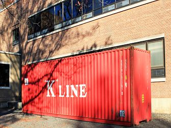 The cargo shipping container before its transformation.