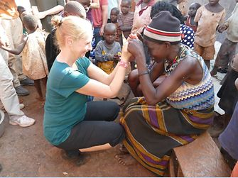 Gabriele Haak from Germany with the mother of one of the girls who lives in the Mirembe Cottage of Street Girls in Jinja, Uganda