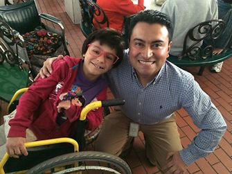 "Mauricio Sandoval from Henkel Colombia with little Paula from the ""Hogar Luz y Vida"" foundation."