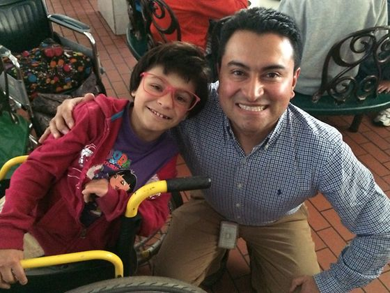 "Mauricio Sandoval from Henkel Colombia with little Paula from the ""Hogar Luz y Vida"" foundation"