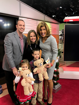 Henkel's Michael Lyons and his family pose with NBC's Hoda Kotb after the reveal of Henkel's record-setting Toy Drive donation.