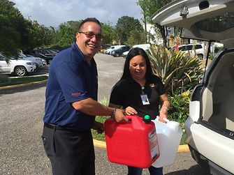 Emergency aid after devastating hurricane Maria in 2017: Henkel provided employees with containers of water and fuel which were in short supply.