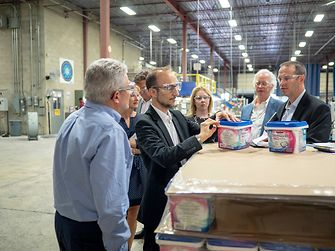 Bruno Piacenza inspects one of JemPak's products during the Oakville plant tour. JemPak manufactures and distributes store-brand laundry and dish cleaning products for a range of retail stores.