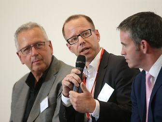 Kersten Heuser of Siemens during the panel discussion (to his right is Joe DeSimone of Carbon and to his right, Government Minister Damien English)