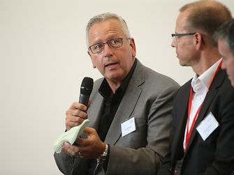 Joe DeSimone of Carbon during the panel discussion (to his left are Kersten Heuser of Siemens, and Damien English, Government Minister)