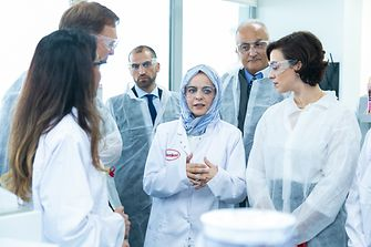 Olfa Aouida, Head of R&D MEA, Beauty Care (middle) showcasing the facilities of the new lab.
