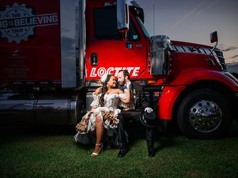 "Rick Stowers and Ashley Conner with the Loctite ""Seeing Is Believing"" trailer at the wedding ceremony"