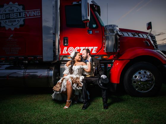 """Rick Stowers and Ashley Conner with the Loctite """"Seeing Is Believing"""" trailer at the wedding ceremony"""