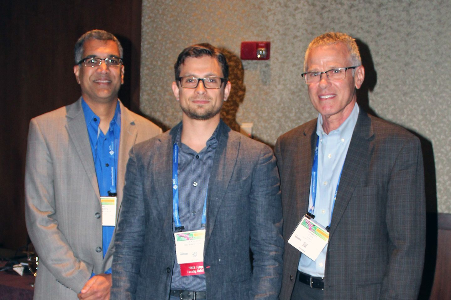 At the symposium the American Chemical Society, Coordinator of the award (left) Prof. Mahesh Mahanthappa from the University of Minnesota and Dr. Charles Paul (right), Vice President of Technology, Adhesive Technologies, join to recognize the award recipient Aleksandr V. Zhukhovitskiy from the Massachusetts Institute of Technology.