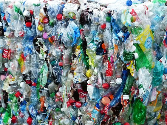 a wall of compressed plastic waste