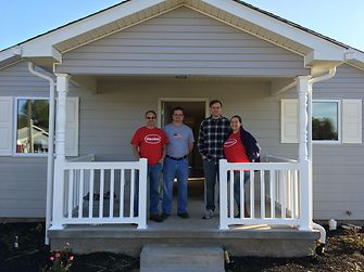 Four of the 39 team members from Henkel's Bowling Green facility who worked over the course of two days to finish this Habitat for Humanity® home.
