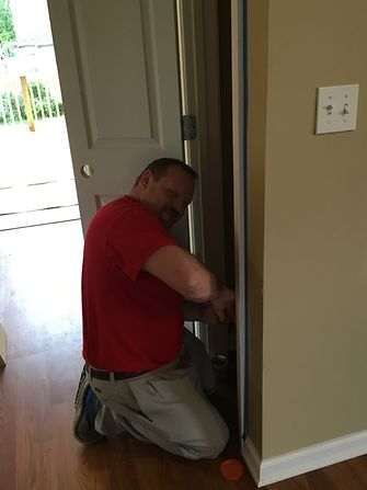 A Henkel employee puts the finishing touches on a closet for the Habitat for Humanity® home.