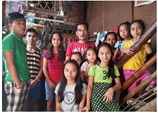 Merly, a Shaping Futures participant in the Philippines and family