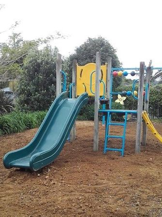 Henkel employees helped spread mulch to even the children's playground at Totara Hospice South Auckland.